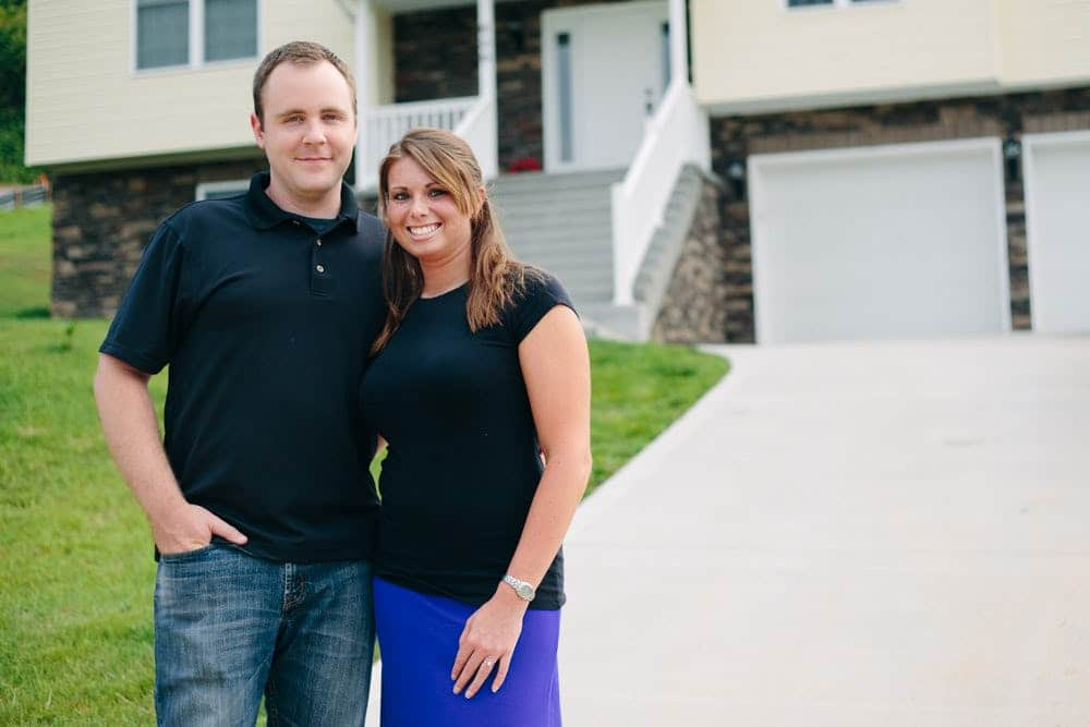 Heather and Rob standing in front of their new home
