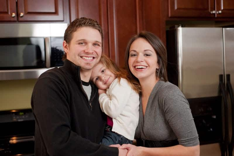 Burdette family in their kitchen together